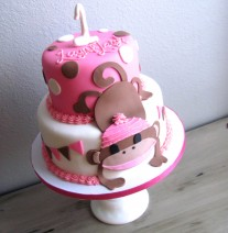 Pink sock monkey birthday cake