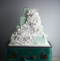 Mint Green and White Rose Petal Wedding Cake on Teal Suitcase