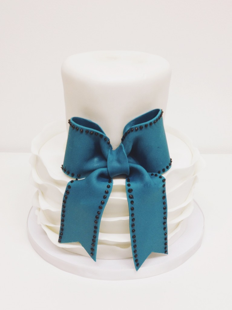 Teal Bow and White Ruffled Cake