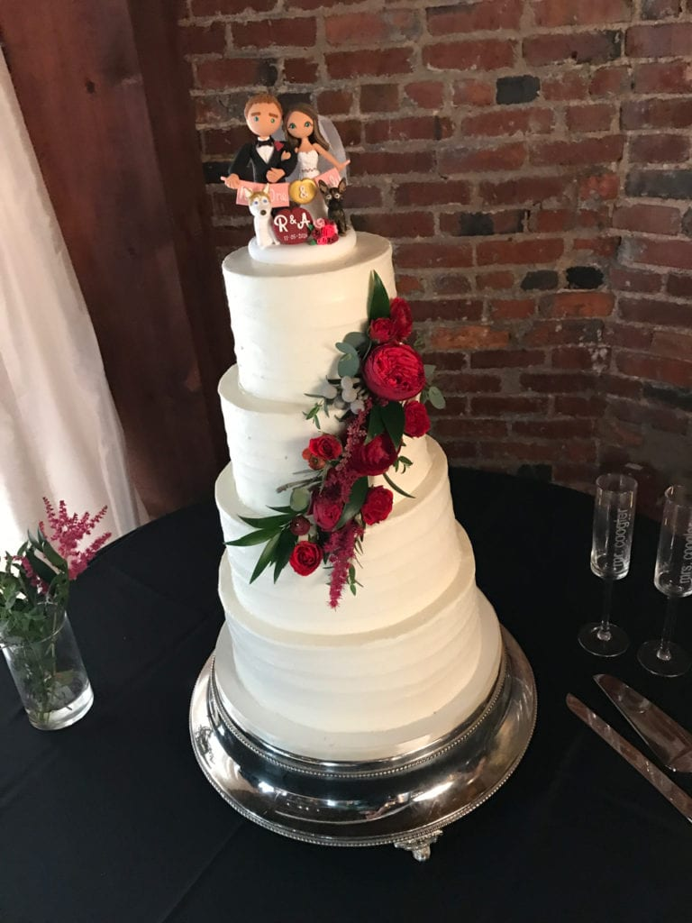Buttercream Wedding Cake With Red Cascading Fresh Flowers